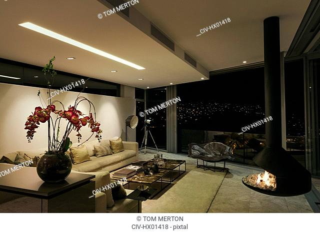 Modern luxury fireplace and home showcase living room at night