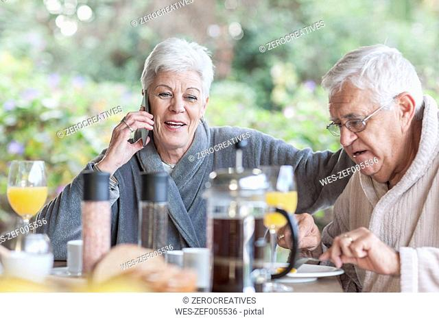 Senior couple having breakfast together on the terrace