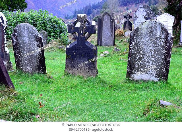 Tombstones in the cemetery of Glendalough, Wicklow county, Ireland