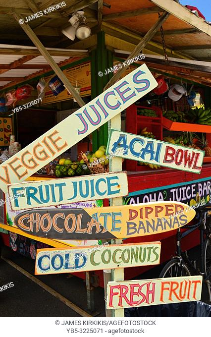 An organic tropical fruit stand displays their offerings