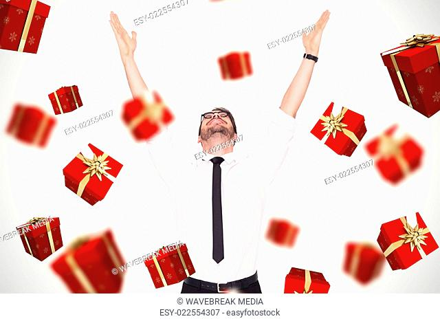 Composite image of smiling businessman cheering with his hands up