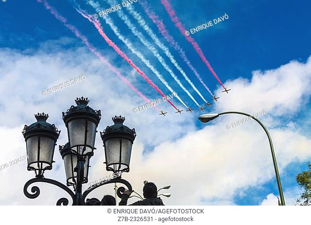 View of color lines of some aeroplanes in the sky of Madrid city, Spain