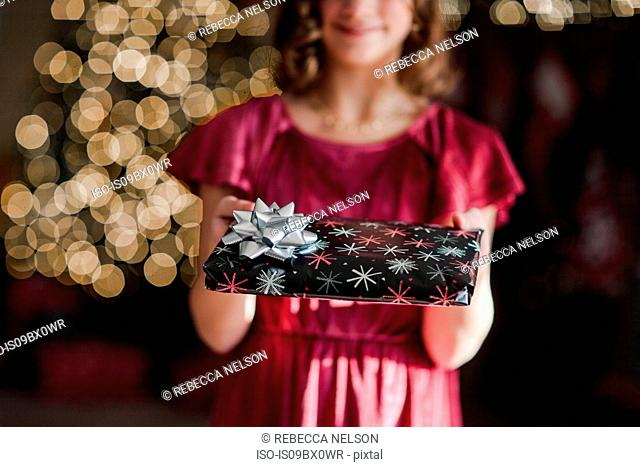 Girl holding Christmas gift