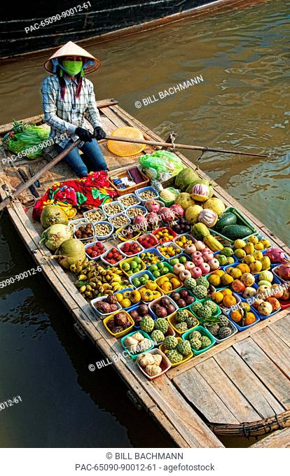 South East Asia, Vietnam, Ha Long Bay, Vietnamese woman sells fresh fruit from her small boat