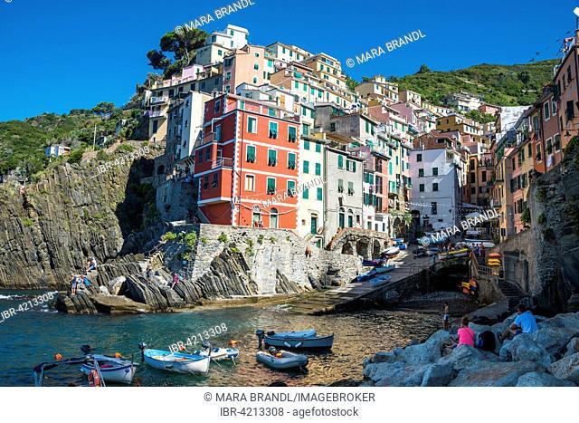 Town view, harbor and colorful houses, Riomaggiore, Cinque Terre, La Spezia Province, Liguria, Italy