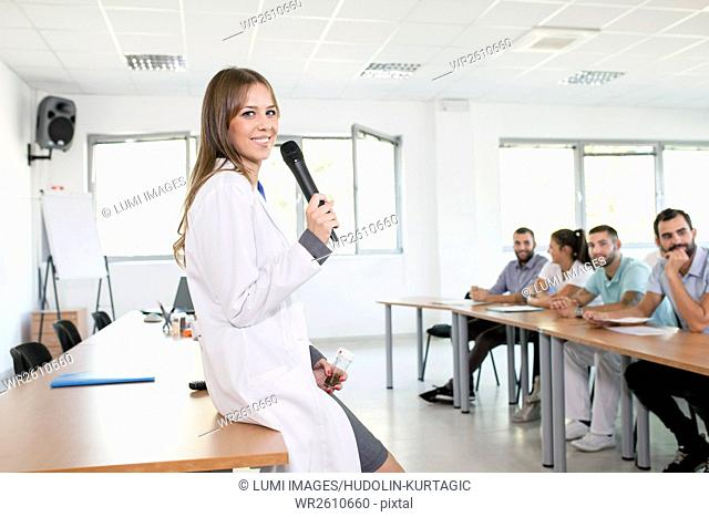 Female instructor gives presentation in training class