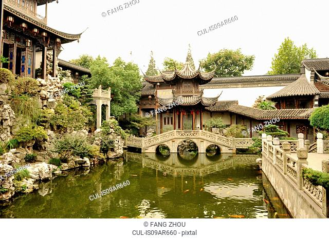 Traditional Chinese garden with fish pool, stone bridge and pavilions, Hangzhou, China