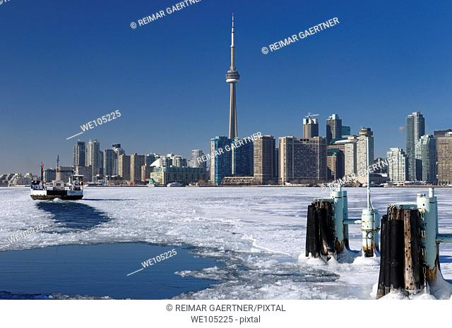 Wards Island Ferry returning to Toronto in winter on an ice covered Lake Ontario