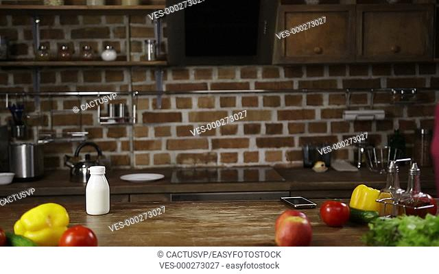 Stressed woman rushing for work in the kitchen