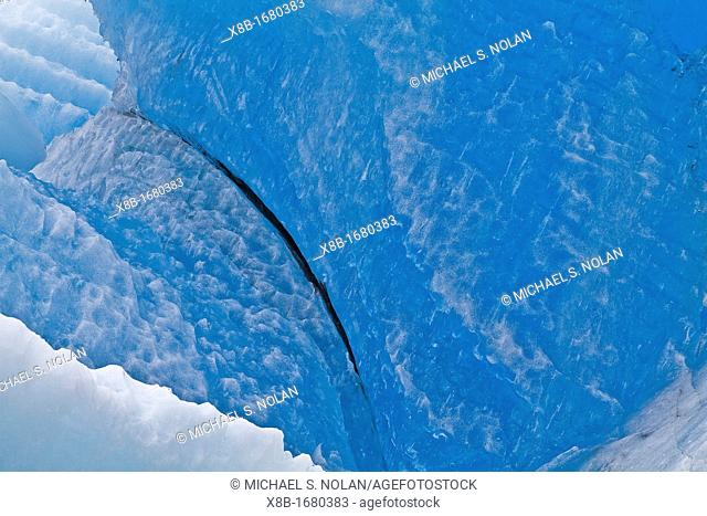 Glacial iceberg detail from ice calved off the South Sawyer Glacier in Tracy Arm, Southeast Alaska, USA, Pacific Ocean