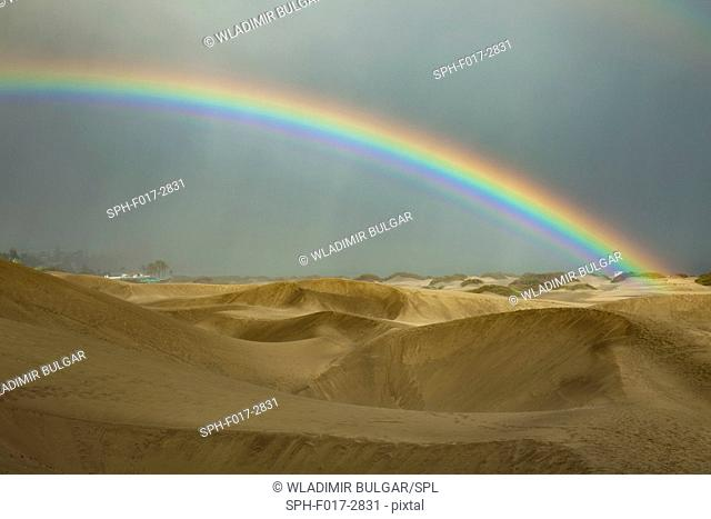 Rainbow over desert, Utah, USA