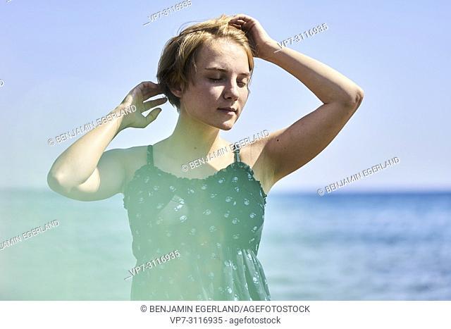 woman at beach in holiday destination Chersonissos, Crete, Greece
