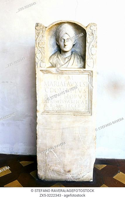Funerary relief dedicated by her friend Caius Domitius Agathopus to Maria Auxesis. Over the epigraph there is a bust of the deceased