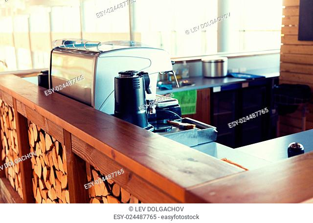 equipment, object and technology concept - close up of coffee machine at bar or restaurant counter