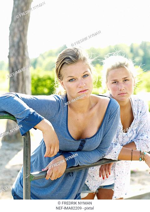 Young women leaning on railings