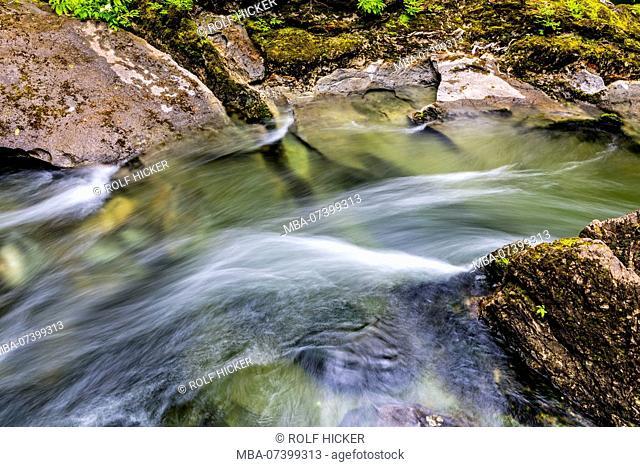 Atluck Creek cutting through the cast limestone creating Huson Natural Bridge Cave in Little Huson Cave Regional Park, Northern Vancouver Island