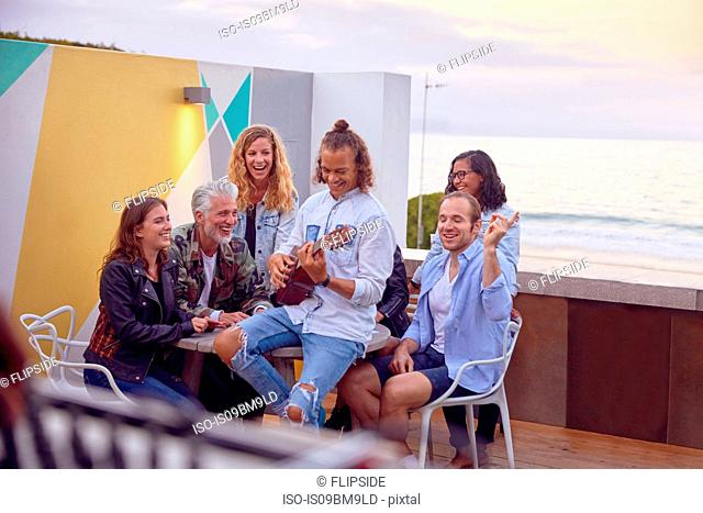 Friends at party by beach, Plettenberg Bay, Western Cape, South Africa