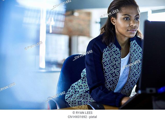 Businesswoman working at laptop in office