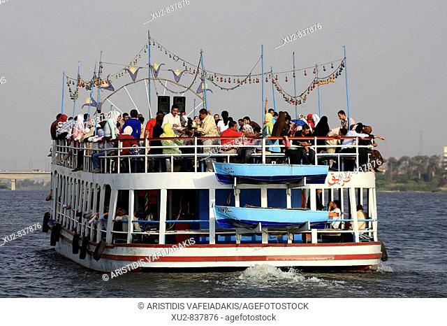 Nile cruise Cairo Egypt. Young Egyptians hire a river boat and they make a party