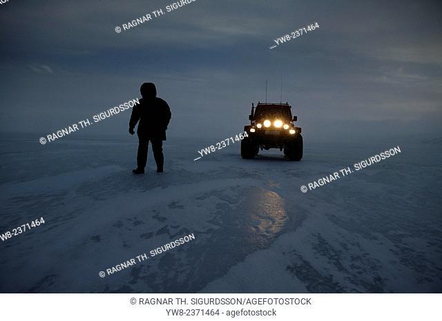 Man and large jeep on Lake Hvitarvatn, Langjokull Ice Cap, Iceland