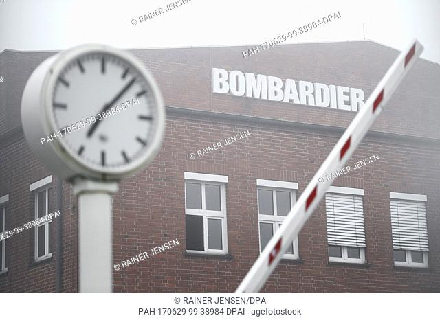 A barrier goes down at the facilities of Bombardier Transportation in Hennigsdorf, Germany, 29 June 2017. The company's supervisoryy board aims to decide...