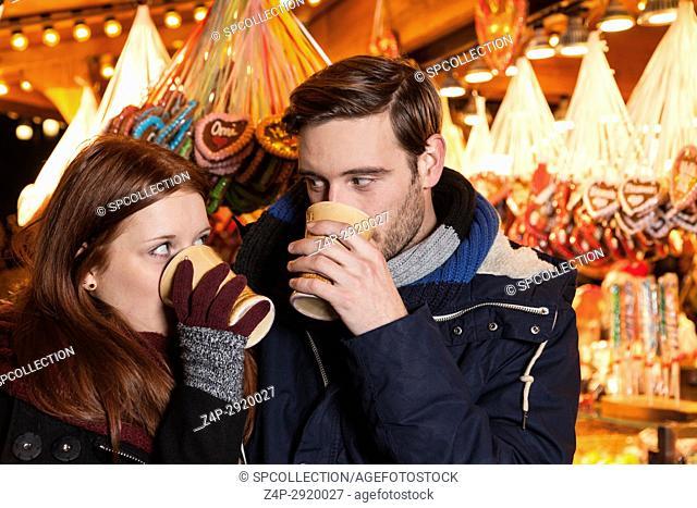 couple drinking wine on christmas market