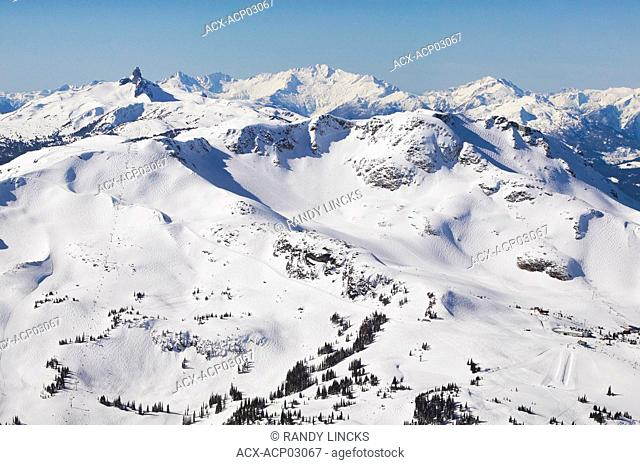 aerial of whistler mountain alpine with harmony and whistler bowls and black tusk in background, british columbia, Canada