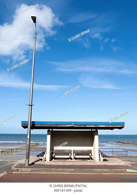 Derelict seaside shelter with streetlight in Colwyn Bay, Glwyd, North Wales, UK