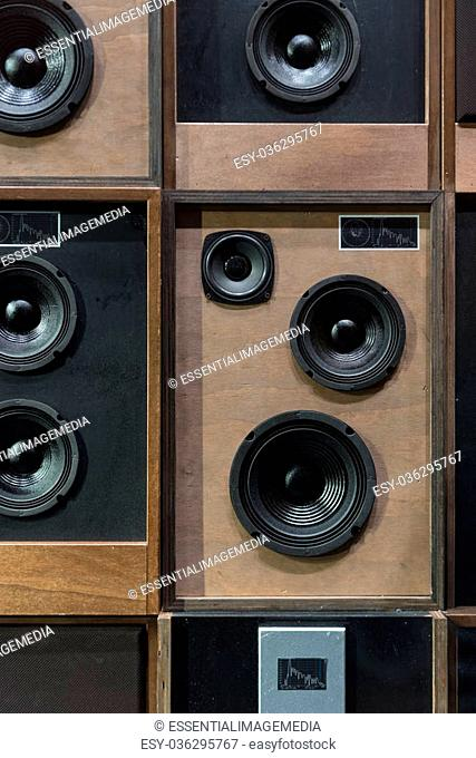 Old Style Wooden Electronic Music Speakers Stacked Next To Each Other