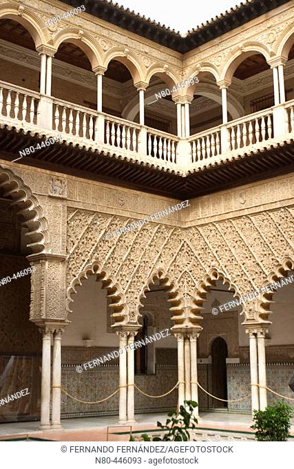 Central courtyard of mudejar palace, Reales Alcázares of Sevilla. Andalusia, Spain