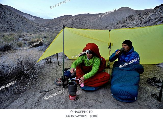 Hikers camping in desert, Cottonwood Canyon, Death Valley National Park, California