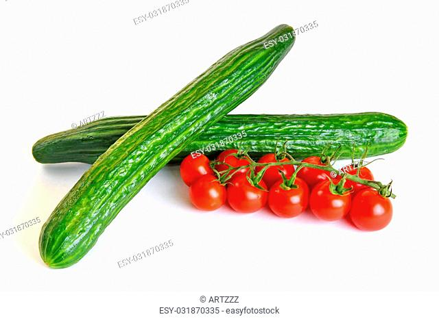 Red cherry tomatoes and green cucumbers isolated on white background