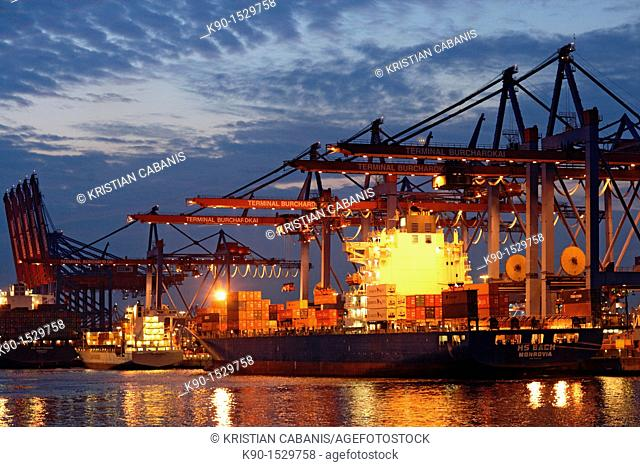 Container cargo boat at a terminal with the river Elbe, Port of Hamburg, Germany, Northern Europe