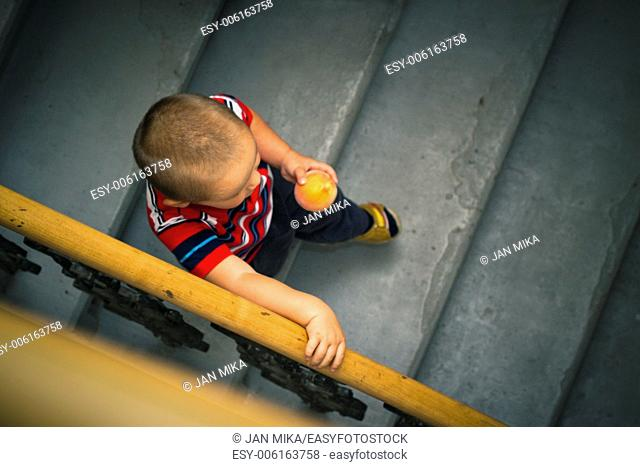 Abstract photo of little boy on the stairs