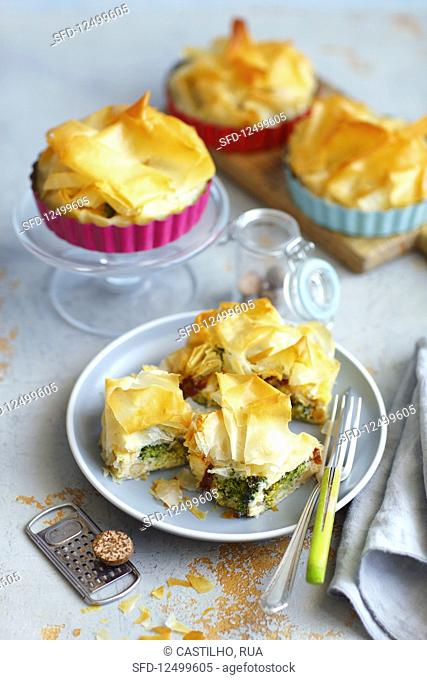 Fritata with broccoli, peas and dried tomatoes baked with filo pastry