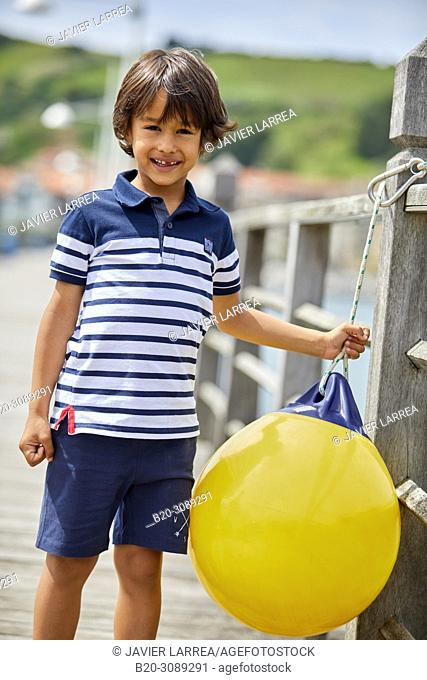 Boy in sailor clothes, Marina Urola, Santiago beach, Zumaia, Gipuzkoa, Basque Country, Spain, Europe