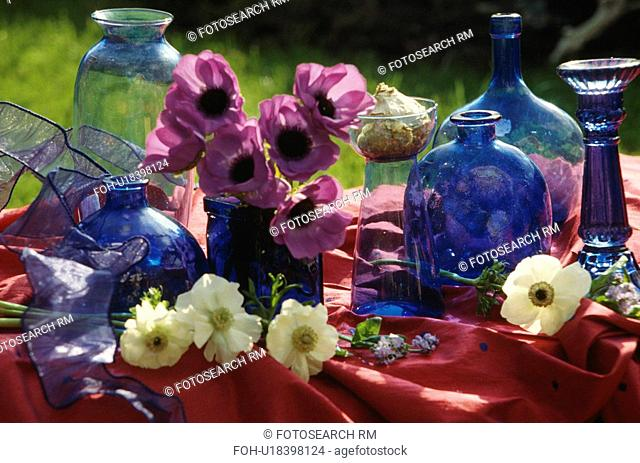 Still-life of blue glass bottles and anemones&13,&10