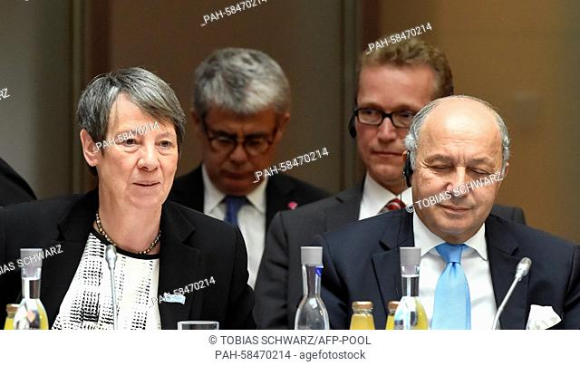 German Environment Minister Barbara Hendricks and French Foreign Minister Laurent Fabius attend the Petersberg Climate Dialogue conference in Berlin, Germany