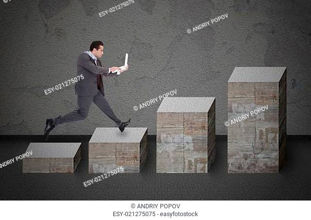 Businessman With Laptop Running On Bar Graph
