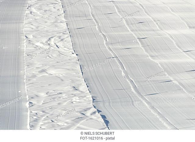 High angle view of freshly groomed corduroy covers ski trail