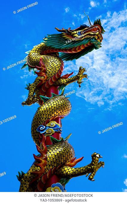 Thailand, Bangkok, Wat Chana Songkram  A statue of a Dragon reaches upwards from a building forming part of the Wat Chana Songkram complex