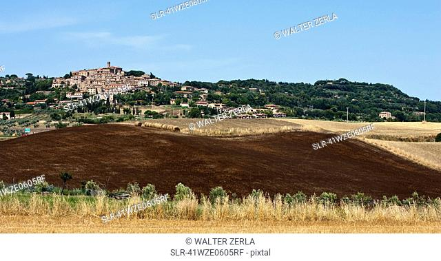 City and crop fields in rural landscape