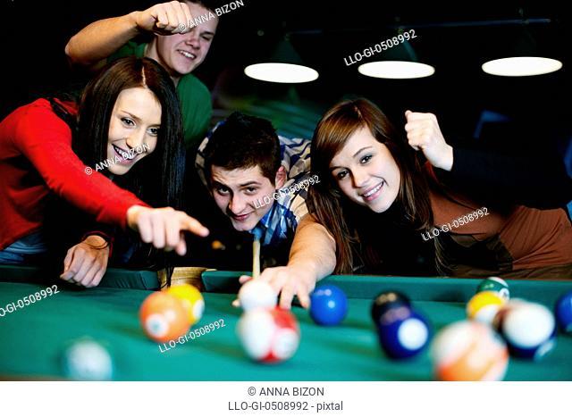 Friends playing billiard Debica, Poland