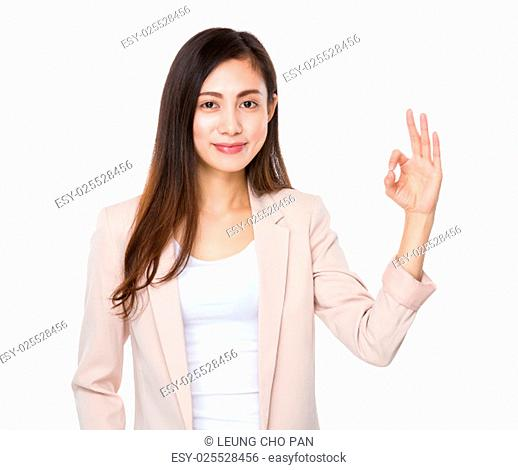 Asian businesswoman with ok sign gesture