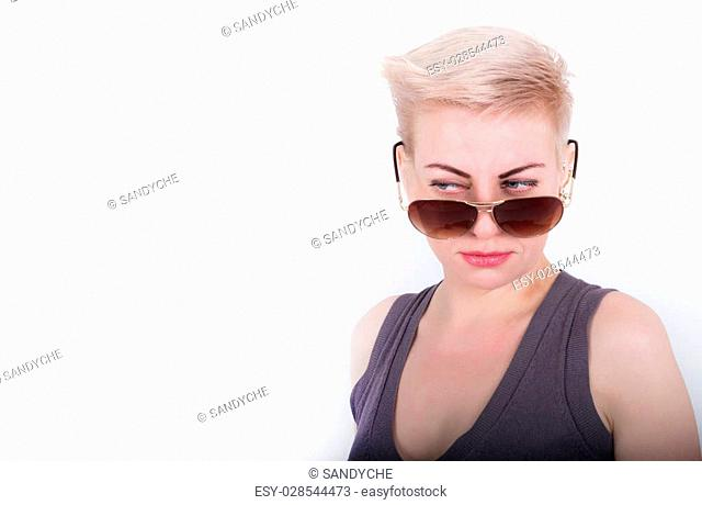 Closeup portrait of sexy whiteheaded young woman with red lips, looking over sunglasses
