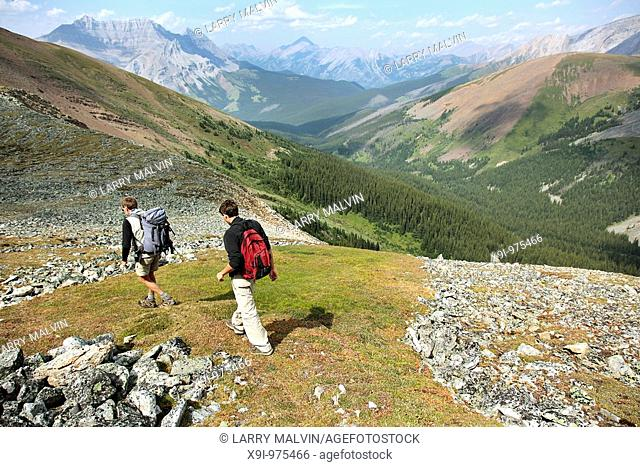 Two men hiking along ridge in Banff National Park, Canada