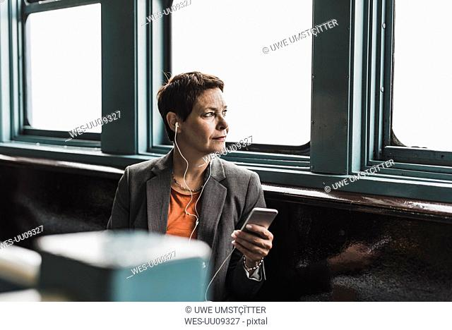 Businesswoman on a ferry looking out of window