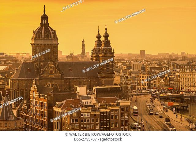 Netherlands, Amsterdam, elevated city skyline with the St-Nicholaskerk church, dusk