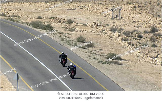Aerial footage of two Police motorcycles in the desert