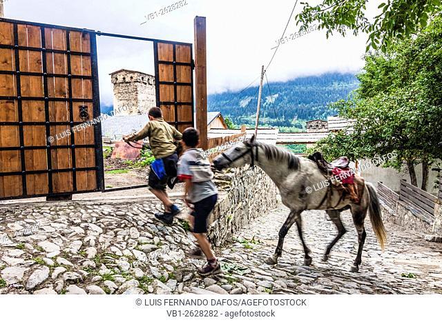 Georgian teens with horse in Mestia, Svaneti, Georgia